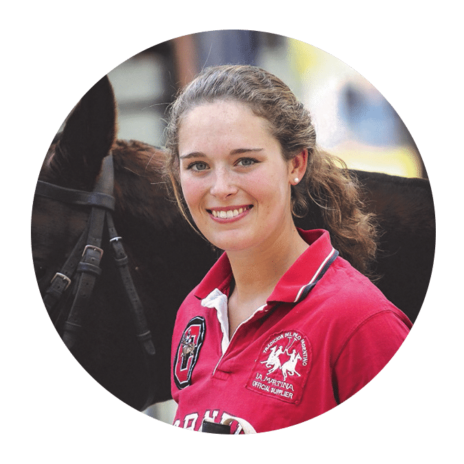 woman with red polo shirt next to bay horse