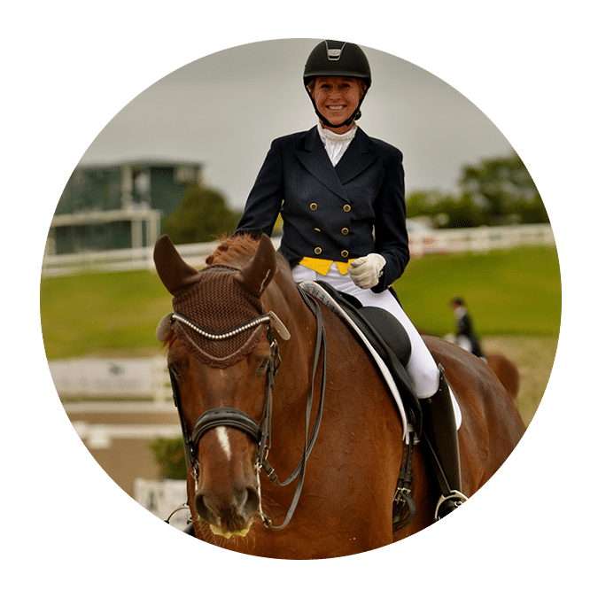 woman on chestnut dressage horse